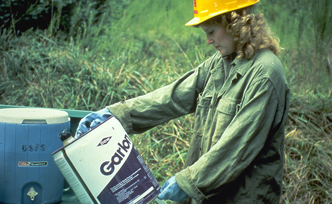 Worker reading label prior to field work