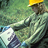Worker reading label prior to field work.