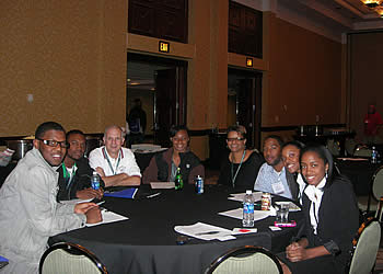 New hires sitted at a table at the SAF Convention Student Orientation and Reception.