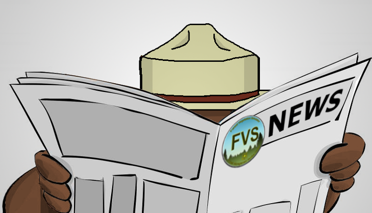 Smokey Bear behind a newspaper with an FVS logo and News on its banner.
