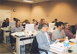 Picture of an FVS training class in progress showing students working with FVS exercises on their PCs.