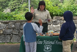 A picture of two youths taking the Junior Forest Ranger pledge.