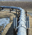 A pipeline on stands curving to the left.