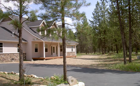 Idaho home with defensible space fostered by an incentive program. Photo by Sarah McCaffrey, USDA Forest Service