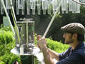 Nick Grant works on an automated rain gauge on the HBEF.