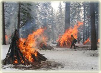 Winter burning of hand piles in Lassen National Park. Photo by Scott Isaacson, National Park Service