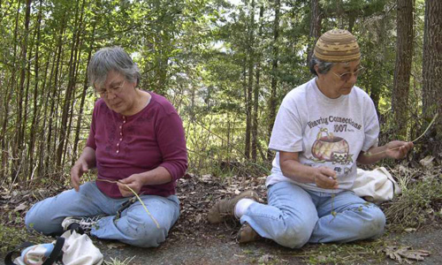 Sisters Lillian Rentz and Janet Morehead of the Karuk Tribe examine harvest California hazel stems from a prescribed burn area. U.S. Forest Service by Frank K. Lake.