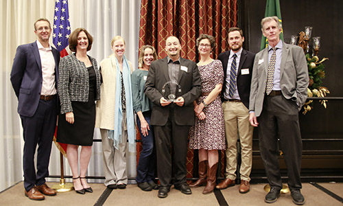 Frank Lake holds the Distinguished Science Award with members of PSW leadership.