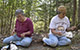 Thumbnail image of sisters Lillian Rentz and Janet Morehead of the Karuk Tribe examine harvest California hazel stems from a prescribed burn area.
