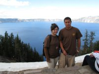 [Photograph]: Crater Lake with two students standing in foreground.