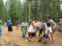 [Photograph]: LEAP Academy students participating in a team building activity.