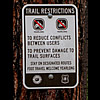 Trial restrictions sign, banning motorized use of the trail.