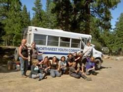 Youth corps members in front of crew bus.