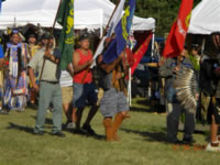Dan Bailey carries the Forest Service flag at the Little River Band of Ottawa Indian's Pow Wow.