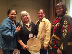 Estelle Bowman poses with Tribal women at the recent celebration of the Wilderness Act's 50th anniversary.