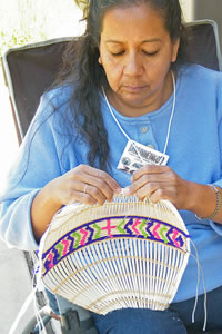 Angie weaving a traditional Paiute cradleboard.
