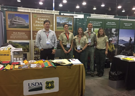 Forest Service personnel staff the booth at the AISES National Conference.