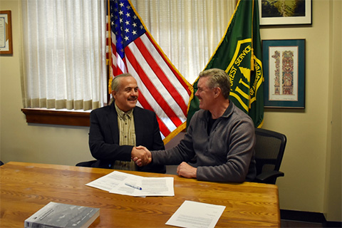 Tongass National Forest Supervisor M. Earl Stewart and Ketchikan Indian Community President Norman Skan shake hands.