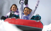 Children tubing at a ski area.