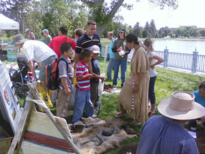 Exhibits, Native American storyteller, and visitors at the Cultural Connections Zone of the Denver National Get Outdoors event.