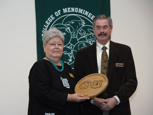 Verna Fower receives a plaque presented by Chris Risbrudt.