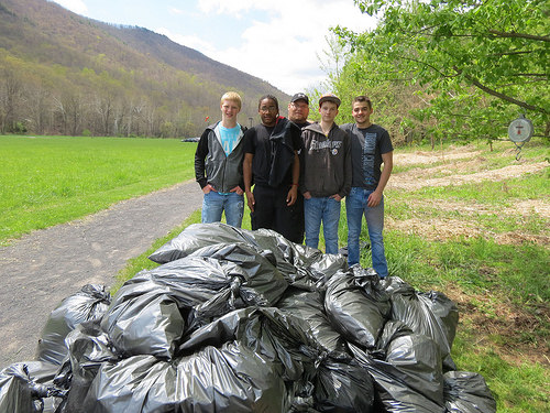 Students from the Elkins Mountain School in Elkins, Virginia, participate in Garlic Mustard Challenge, filling bags of the invasive species. (U.S. Forest Service)