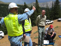 Federal Highway Administration and Forest Service officials discussing rerouting alternatives at the site of the Guanella Pass moonworts.