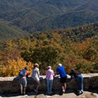Visitors enjoy the fall colors while taking a moment to gaze across the landscape from the Wayah Fire Tower on the Nantahala National Forest in North Carolina. (U.S. Forest Service)