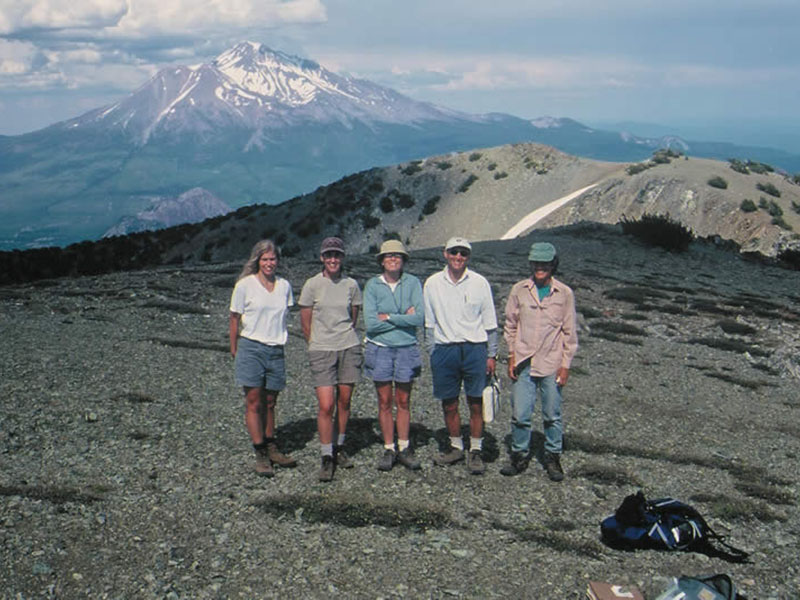 Shasta-Trinity National Forest botanists on the serpentine alpine summit of Mt. Eddy. Mt. Shasta is in the background