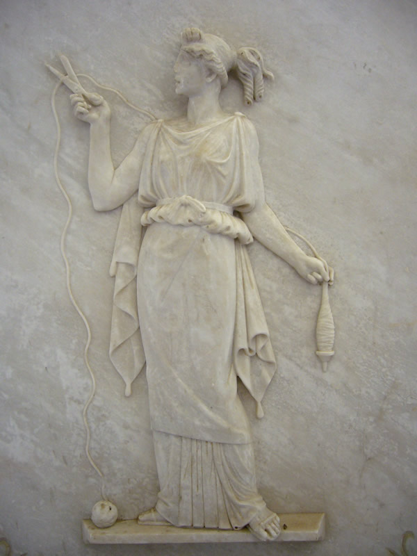 Early Greek stone relief of Atropos with her deadly shears