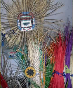 Finely woven Hopi wicker plaques and dyed rabbitbrush and sumac stems.