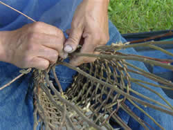 Man weaving a fish trap.
