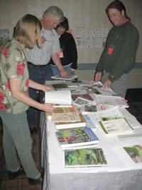 students at the ESRU training session looking at publications spread out on a table.