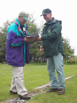 District Ranger Dave Silvieus presents the WATA to volunteer Bill Benesch.