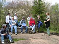 hikers listening to a Forest Service guide on a hike of the Oberg Mountain Trail.