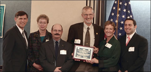 Pictured in the photo, from left to right, are: J. Richard Capka, Federal Highway Administration Acting Administrator; Donna Sheehy, Forest Service Traffic Management Engineer in Region 1 (Montana); Doug Moeller of the Montana Department of Transportation; John Bell, Forest Service National Road System Operations and Maintenance Engineer (Washington, DC); Sally Collins, Forest Service Associate Chief (Washington, DC); and Gregory Cohen, Roadway Safety Foundation Executive Director.