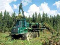 Picture of a John Deere bundling machine in action.